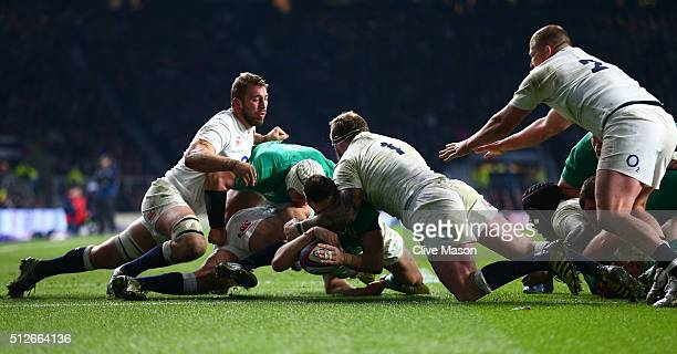Conor Murray of Ireland burrows over to score the opening try during the RBS Six Nations match between England and Ireland at Twickenham Stadium on...