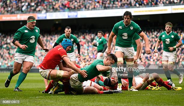 Conor Murray of Ireland crashes through the tackle from Justin Tipuric of Wales to score the opening try during the RBS Six Nations match between...