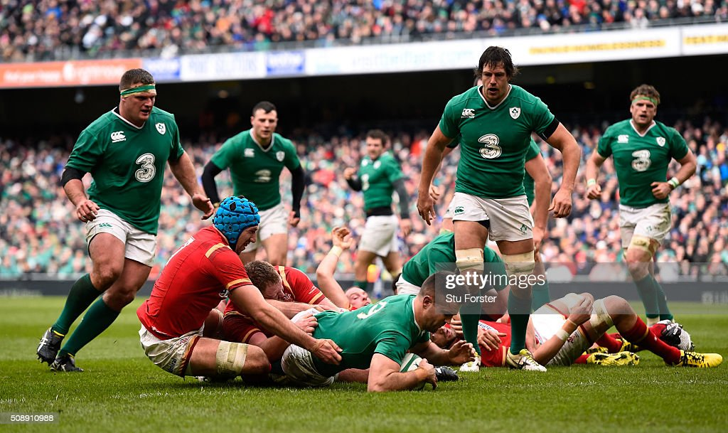 <a gi-track='captionPersonalityLinkClicked' href=/galleries/search?phrase=Conor+Murray+-+Rugby+Player&family=editorial&specificpeople=6820654 ng-click='$event.stopPropagation()'>Conor Murray</a> of Ireland crashes through the tackle from <a gi-track='captionPersonalityLinkClicked' href=/galleries/search?phrase=Justin+Tipuric&family=editorial&specificpeople=6739194 ng-click='$event.stopPropagation()'>Justin Tipuric</a> of Wales to score the opening try during the RBS Six Nations match between Ireland and Wales at the Aviva Stadium on February 7, 2016 in Dublin, Ireland.