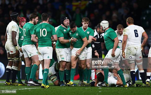 Conor Murray of Ireland is congratulated by teammates after scoring the opening try during the RBS Six Nations match between England and Ireland at...