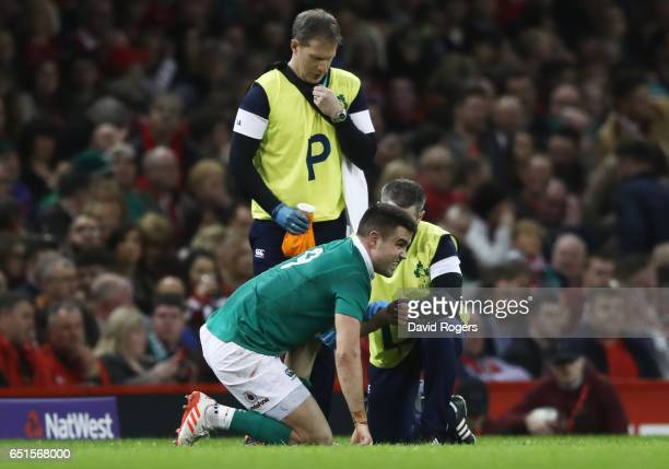 Conor Murray of Ireland is given treatment during the Six Nations match between Wales and Ireland at the Principality Stadium on March 10 2017 in...