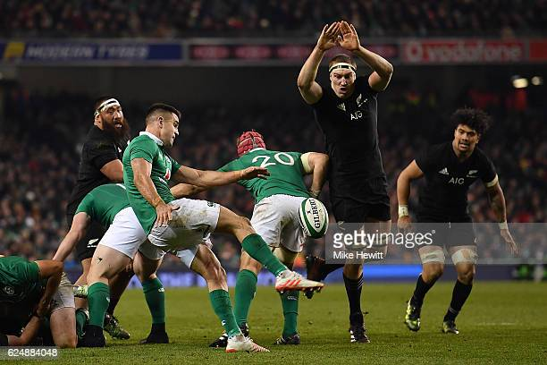 Conor Murray of Ireland kicks ahead under pressure from Brodie Retallick of New Zealand during the International Friendly between Ireland and New...