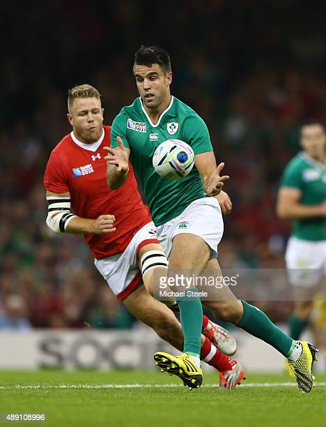 Conor Murray of Ireland ofloads during the 2015 Rugby World Cup Pool D match between Ireland and Canada at the Millennium Stadium on September 19...