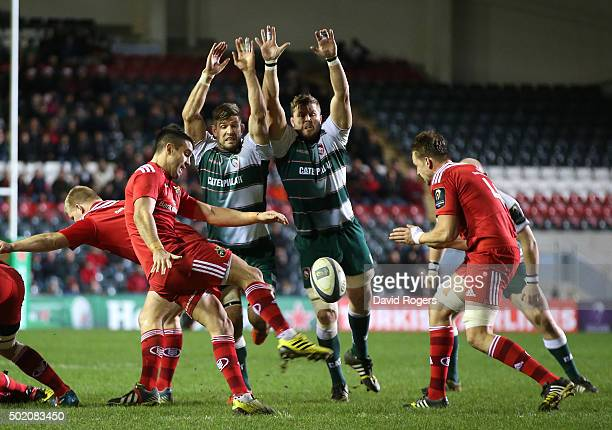 Conor Murray of Munster clears the ball as Mike Fitzgerald and Ed Slater attempt to block during the European Rugby Champions Cup match between...