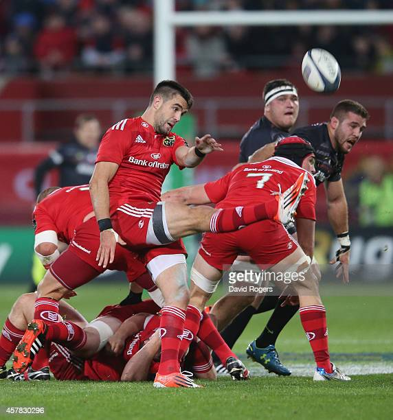 Conor Murray of Munster kicks the ball upfield during the European Rugby Champions Cup match between Munster and Saracens at Thomond Park on October...