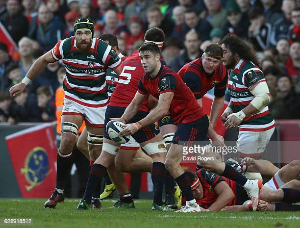 Conor Murray of Munster passes the ball during the European Champions Cup match between Munster and Leicester Tigers at Thomond Park on December 10...