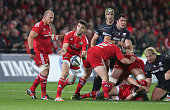 Conor Murray of Munster passes the ball during the European Rugby Champions Cup match between Munster and Saracens at Thomond Park on October 24 2014...