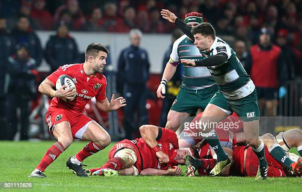 Conor Murray of Munster takes on Ben Youngs during the European Rugby Champions Cup match between Munster and Leicester Tigers at Thomond Park on...