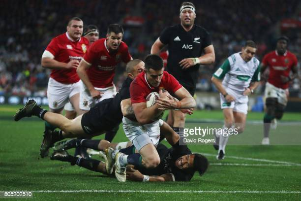 Conor Murray of the Lions dives over the line to score his team's second try during the second test match between the New Zealand All Blacks and the...