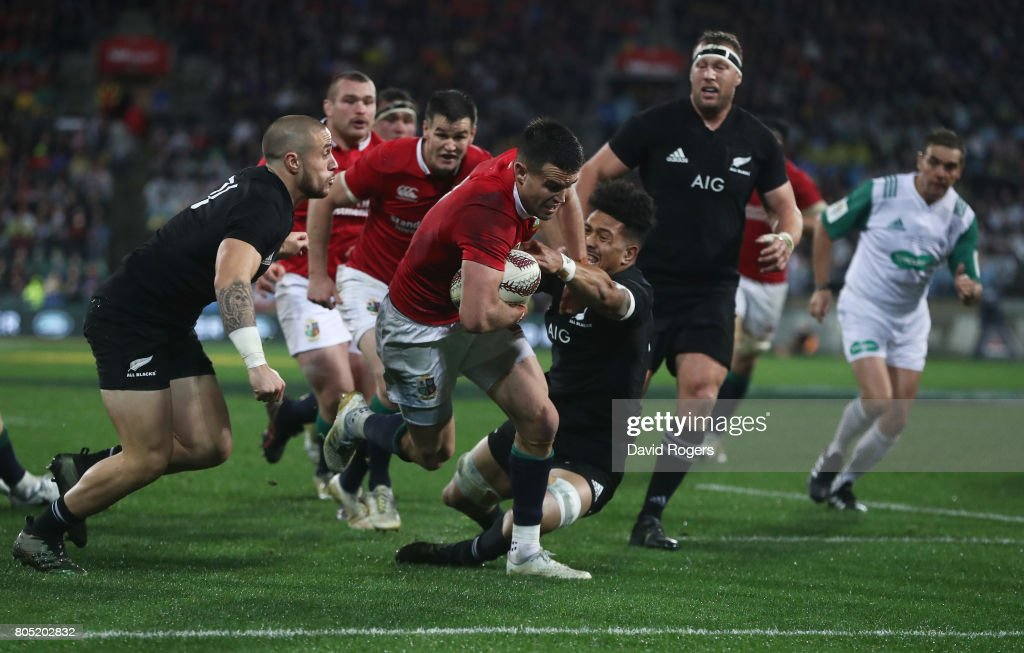 Conor Murray of the Lions hands off Ardie Savea of the All Blacks to score his team's second try during the second test match between the New Zealand All Blacks and the British & Irish Lions at the Westpac Stadium on July 1, 2017 in Wellington, New Zealand.