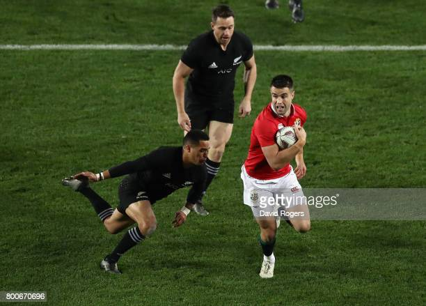 Conor Murray of the Lions is tackled by Aaron Smith during the Test match between the New Zealand All Blacks and the British Irish Lions at Eden Park...