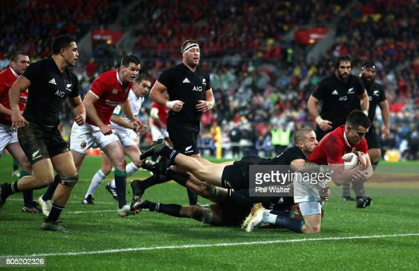 Conor Murray of the Lions scores his sides second try during the International Test match between the New Zealand All Blacks and the British Irish...