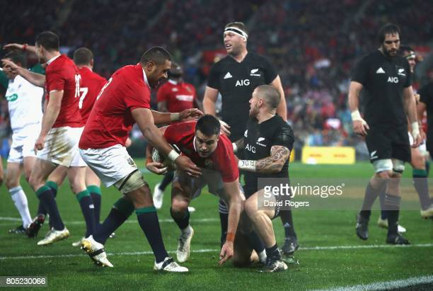 Conor Murray the Lions scrumhalf celebrates with Taulupe Faletau after scoring their second try during the match between the New Zealand All Blacks...