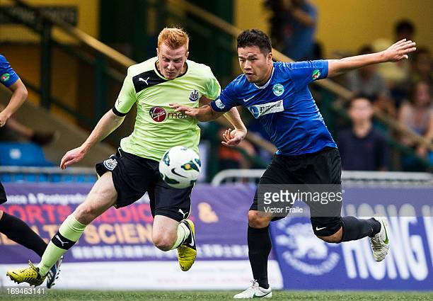 Conor Newton of Newcastle United and Ha Shing Chi of Southern fight for the ball on day two of the Hong Kong International Soccer Sevens at Hong Kong...