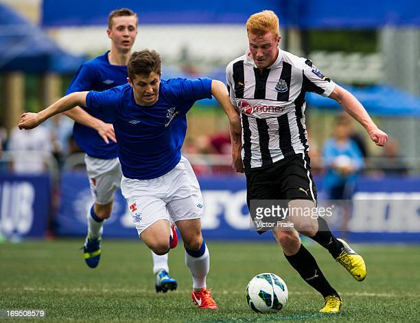 Conor Newton of Newcastle United and Robbie Crawford Rangers fight for the ball on day three of the Hong Kong International Soccer Sevens at Hong...
