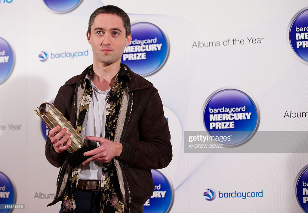 Conor O'Brien from the Irish indie folk band 'Villagers' poses with their Albums of the Year trophy at the 2013 Mercury Prize awards ceremony in central London on October 30, 2011. The Mercury Prize seeks to promote the best of UK and Irish music and the artists that produce it. This is done primarily through the celebration of the 12 Albums of the Year. The12 shortlisted artists receive a specially commissioned bronze Albums of the Year trophy.