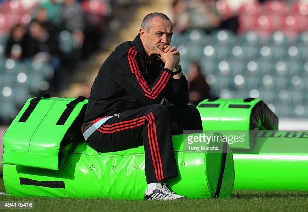 Conor O'Shea director of rugby of Harlequins sits on a tackle bag before the Aviva Premiership match between Leicester Tigers and Harlequins at...