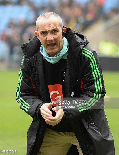 Conor O'Shea Director of Rugby of Wasps is tackled by xxxx of Harlequins during the Aviva Premiership match between Wasps and Harlequins at the Ricoh...