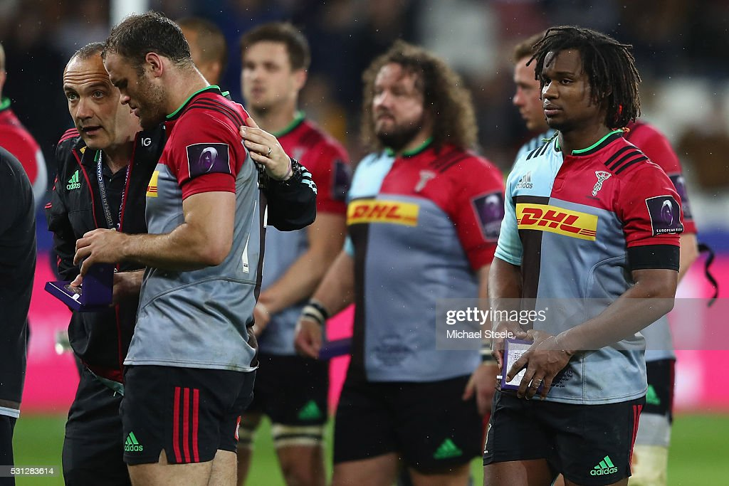Conor O'Shea the Director of Rugby of Harlequins consoles Jamie Roberts after their 1926 defeat during the European Rugby Challenge Cup Final match...