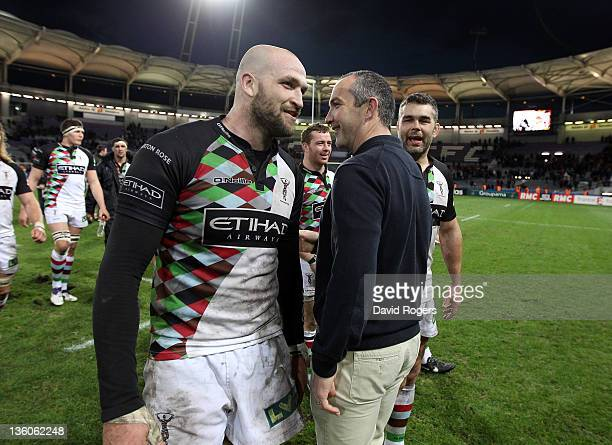 Conor O'Shea the Harlequins director of rugby congratutulates George Robson and Nick Easter during the Heineken Cup match between Toulouse and...