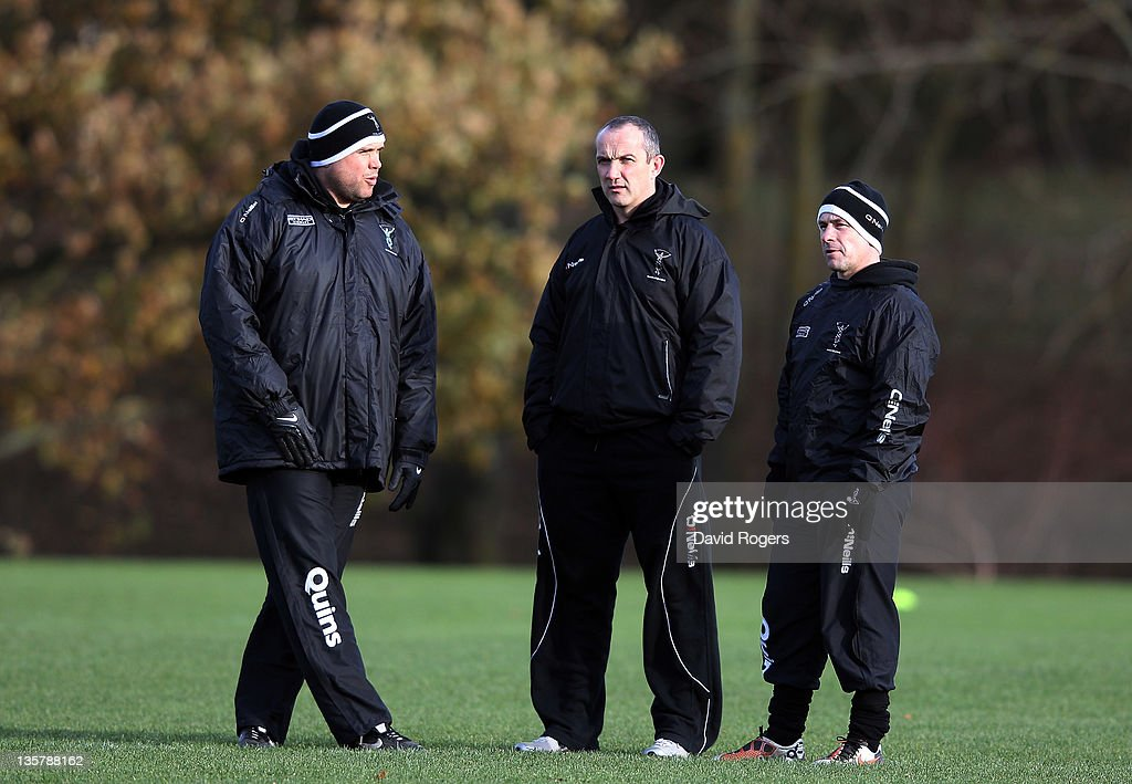 Conor O'Shea the Harlequins director of rugby looks on with his assistant coaches Mark Mapletoft and Tony Diprose during the Harlequins training...