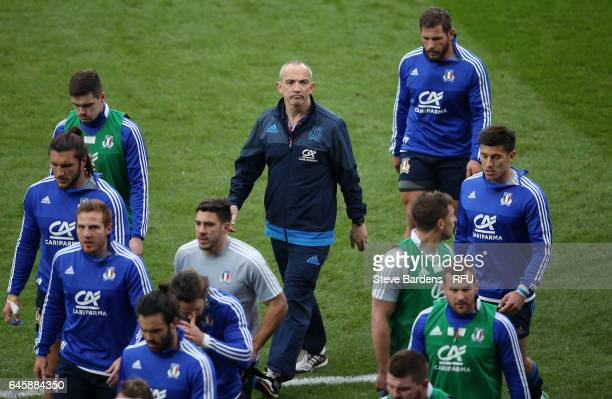 Conor O'Shea the head coach of Italy watches over his team's pre match warm up during the RBS Six Nations match between England and Italy at...