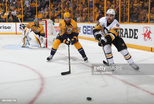 Conor Sheary of the Pittsburgh Penguins and Roman Josi of the Nashville Predators vie for the puck in the second period of Game Six of the 2017 NHL...