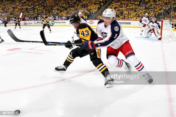 Conor Sheary of the Pittsburgh Penguins and Zach Werenski of the Columbus Blue Jackets battle for the puck in Game One of the Eastern Conference...