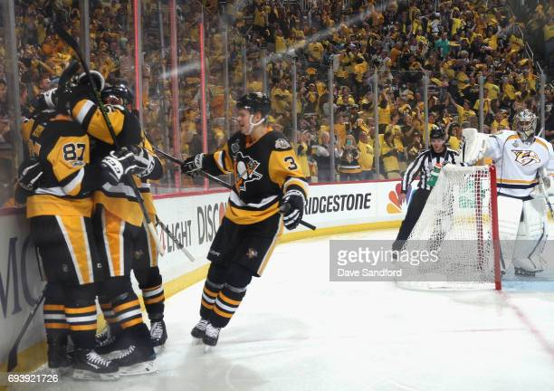 Conor Sheary of the Pittsburgh Penguins celebrates his goal with teammates as goaltender Juuse Saros of the Nashville Predators looks on during the...
