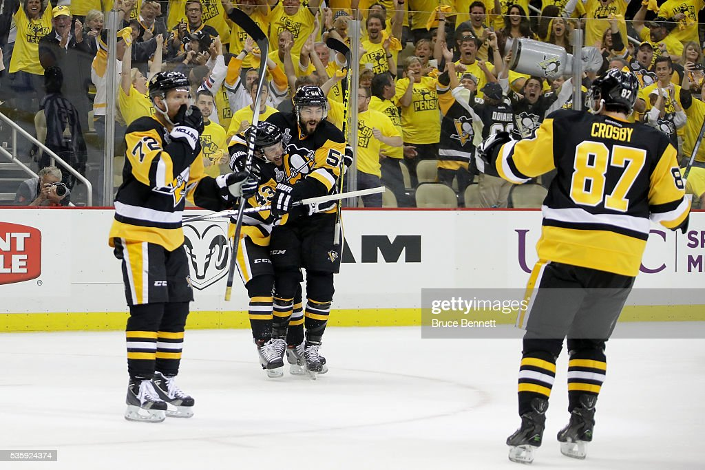Conor Sheary of the Pittsburgh Penguins celebrates with Kris Letang after scoring a first period goal against the San Jose Sharks in Game One of the...