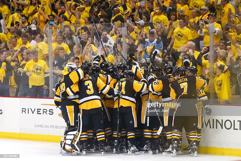 Conor Sheary of the Pittsburgh Penguins celebrates with teammates after scoring the gamewinning goal to defeat the San Jose Sharks 21 during overtime...
