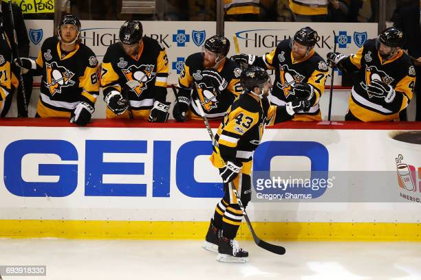 Conor Sheary of the Pittsburgh Penguins celebrates with teammates after scoring his team's fourth goal against the Nashville Predators in the second...