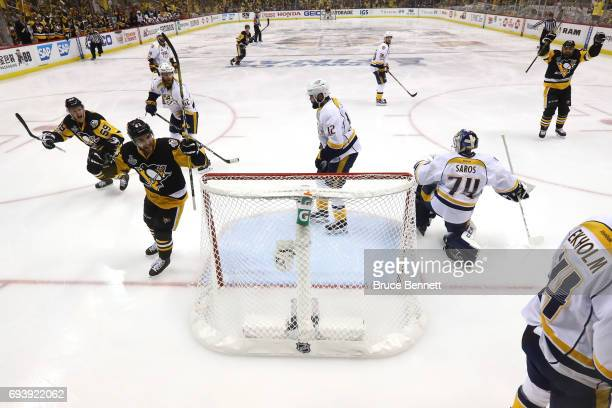 Conor Sheary of the Pittsburgh Penguins celebrates with teammates after scoring his team's fourth goal in the second period against Juuse Saros of...
