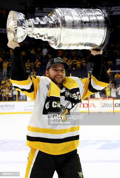 Conor Sheary of the Pittsburgh Penguins celebrates with the Stanley Cup trophy after they defeated the Nashville Predators 20 in Game Six of the 2017...
