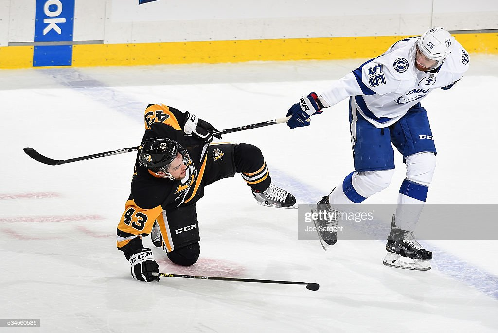 Conor Sheary #43 of the Pittsburgh Penguins gets tripped up by <a gi-track='captionPersonalityLinkClicked' href=/galleries/search?phrase=Braydon+Coburn&family=editorial&specificpeople=2077063 ng-click='$event.stopPropagation()'>Braydon Coburn</a> #55 of the Tampa Bay Lightning in Game Seven of the Eastern Conference Final during the 2016 NHL Stanley Cup Playoffs at Consol Energy Center on May 26, 2016 in Pittsburgh, Pennsylvania.