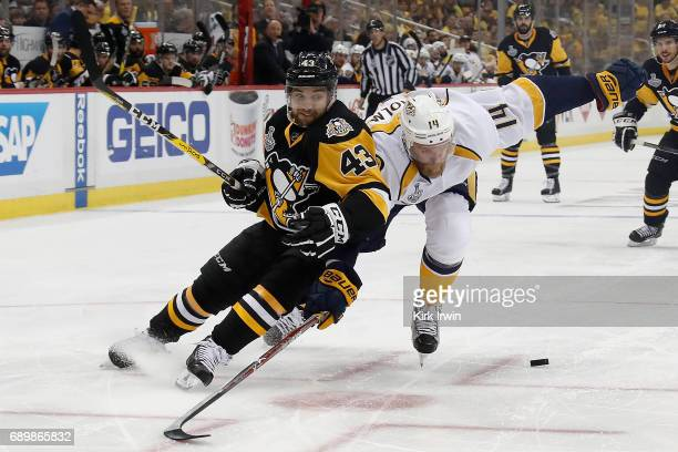 Conor Sheary of the Pittsburgh Penguins is defended by Mattias Ekholm of the Nashville Predators during the second period of Game One of the 2017 NHL...