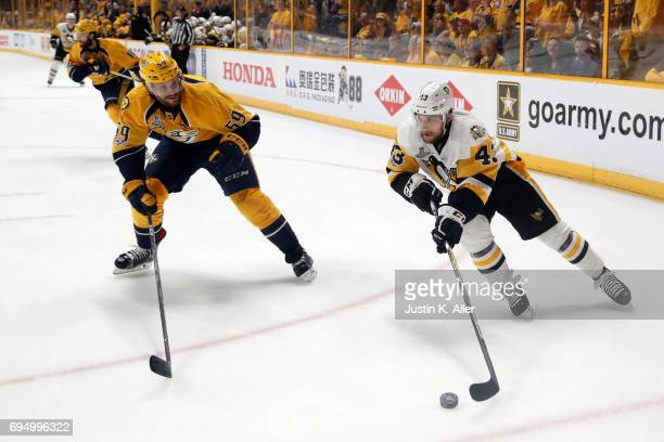 Conor Sheary of the Pittsburgh Penguins is defended by Roman Josi of the Nashville Predators during the second period in Game Six of the 2017 NHL...