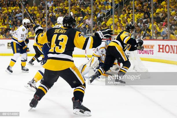 Conor Sheary of the Pittsburgh Penguins reacts after Jake Guentzel scores a goal past Pekka Rinne of the Nashville Predators during the first period...