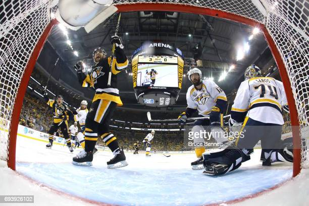 Conor Sheary of the Pittsburgh Penguins scores his team's fourth goal against Juuse Saros of the Nashville Predators in the second period in Game...