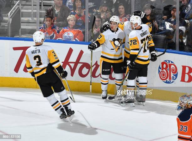 Conor Sheary Patric Hornqvist Sidney Crosby and Olli Maatta of the Pittsburgh Penguins celebrate after a goal during the game against the Edmonton...