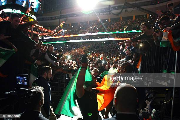 Conor 'The Notorious' McGregor of Ireland enters the arena before facing Dennis Siver during the UFC Fight Night event at the TD Garden on January 18...