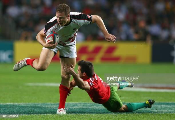 Conor Trainor of Canada is tackled during the Pool C match between Canada and Portugal during day one of the 2014 Hong Kong Sevens at Hong Kong...