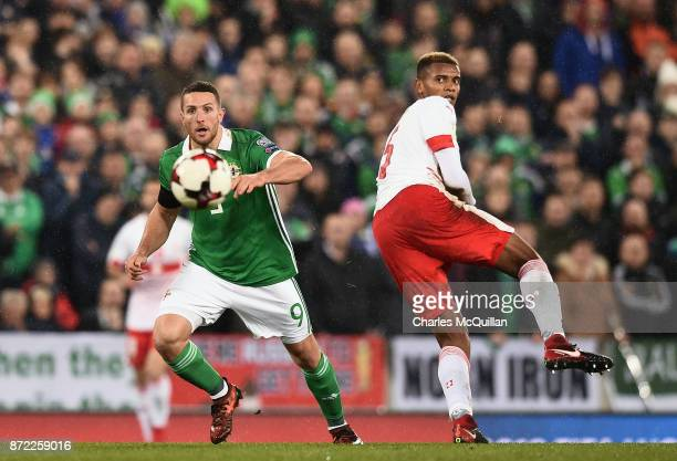 Conor Washington of Northern Ireland and Manuel Akanji of Switzerland during the FIFA 2018 World Cup Qualifier PlayOff first leg between Northern...