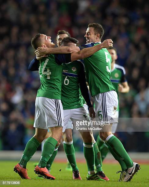 Conor Washington of Northern Ireland celebrates with teammates after scoring during the international friendly between Northern Ireland and Slovenia...