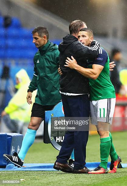 Conor Washington of Northern Ireland hugs with manager Michael O'Neill during the UEFA EURO 2016 Group C match between Ukraine and Northern Ireland...