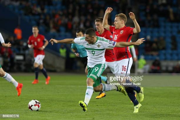 Conor Washington of Northern Ireland in action against Jonas Svensson of Norway during the FIFA 2018 World Cup Qualifier between Norway and Northern...