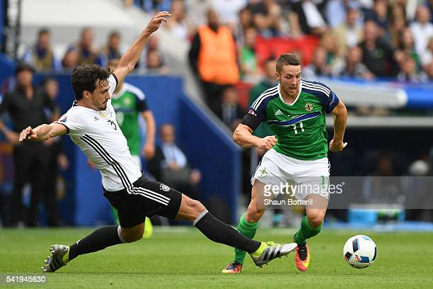 Conor Washington of Northern Ireland is tackled by Mats Hummels of Germany during the UEFA EURO 2016 Group C match between Northern Ireland and...