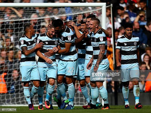 Conor Washington of QPR celebrates with team mates after scoring the opening goal of the game during the Sky Bet Championship match between Fulham...