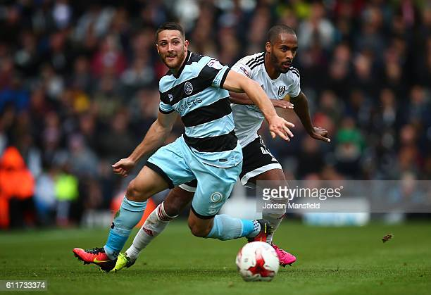 Conor Washington of Queens Park Rangers and Denis Odoi of Fulham challenge for the ball during the Sky Bet Championship match between Fulham and...