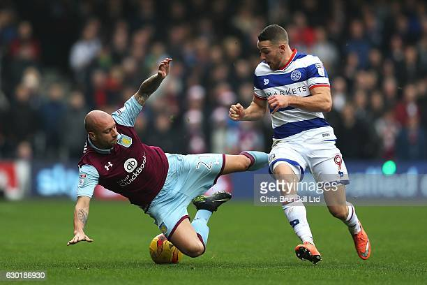 Conor Washington of Queens Park Rangers fouls Alan Hutton of Aston Villa during the Sky Bet Championship match between Queens Park Rangers and Aston...